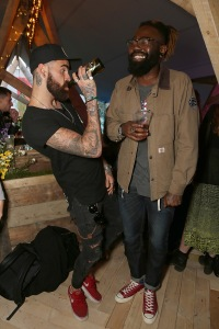 LONDON, ENGLAND - JUNE 10: Chris Perceval and Mikill Pane enjoy the mystery of the Kopparberg Urban Forest, a free festival running for five weeks in Hackney Wick, on June 10, 2015 in London, England. (Photo by David M. Benett/Getty Images for Kopparberg Urban Forest) *** Local Caption *** Chris Perceval; Mikill Pane